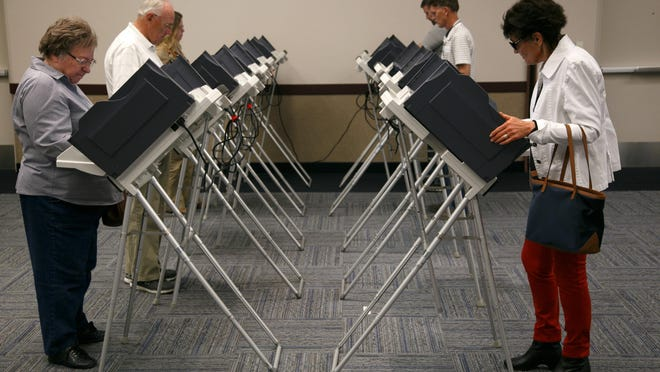 Voters cast their ballots at the Dixie Center in St. George Nov. 4, 2014. The 2015 election season starts with the opening of the filing period for candidates for municipal office.