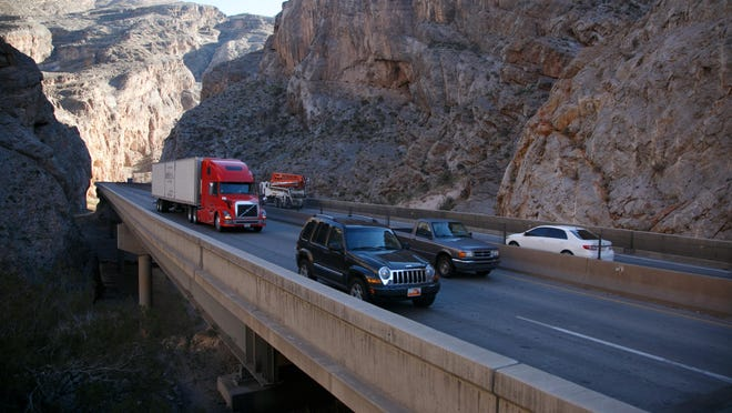 Traffic flows along I-15 through the Virgin River Gorge near mile marker 13 Dec. 21, 2013.