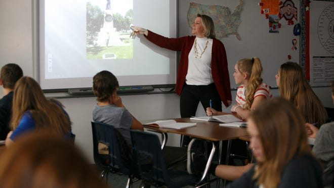 Wendy Gibbons teaches an American History class at Desert Hills Middle School. Gibbons loves her profession, but is concerned for new teachers.