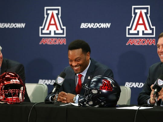 UA president Robert Robbins (left), new UA head football