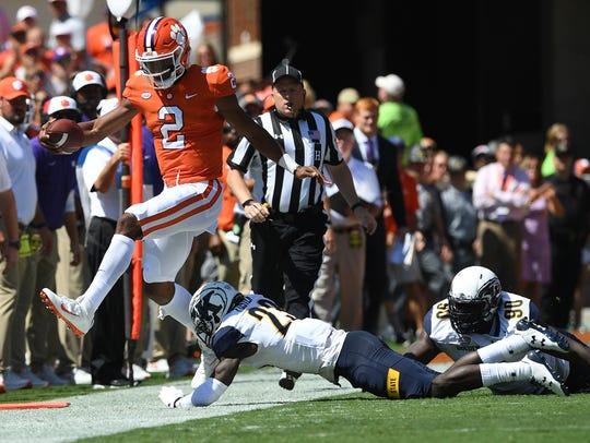 Clemson quarterback Kelly Bryant (2) leaps over Kent