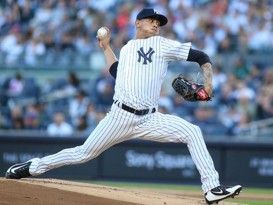 New York Yankees pitcher Jonathan Loaisiga (38) making