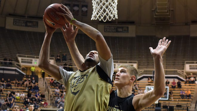 Purdue's A.J. Hammons, left, goes up for a layup over Isaac Haas during a recent scrimmage.