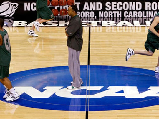 "FILE - In this March 18, 2009, file photo, Binghamton coach Kevin Broadus, center, looks on during a basketball practice for a first round NCAA college basketball game against Duke, in Greensboro, N.C.  The NCAA says it will consider North Carolina as a host for championship events again after the state rolled back a law that limited protections for LGBT people. In a statement Tuesday, April 4, 2017, the governing body said its Board of Governors had reviewed moves to repeal repealed the so-called ""bathroom bill"" and replace it with a compromise law."