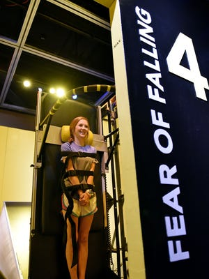 """Dakota Rummel, museum volunteer, waits anxiously for the falling simulation machine to cast her backward at the Mississippi Museum of Natural Science Tuesday. Starting Saturday """"Goose Bumps! The Science of Fear,"""" will be on display through Dec. 30 at the Mississippi Museum of Natural Science."""