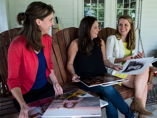 Vanessa Neustrom, Kim Neustrom, and Emily Neustrom look at photographs of their late sister Alison at their family's home in Lafayette, La., Friday, June 5, 2015.