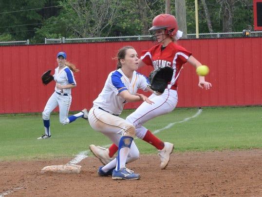 Tioga's Maddie Tullos (14, right) reaches third ahead of the ball thrown to Buckeye third baseman Layni Smith (19, left).
