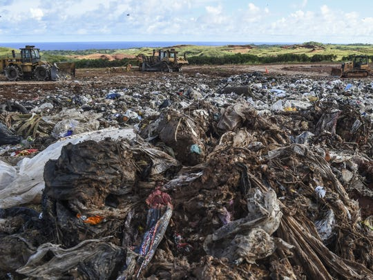 Heavy equipment processes the day's trash at Cell 2 of the Layon Landfill in Inarajan on Oct. 2.