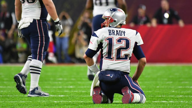 Tom Brady reacts after throwing a pick-six interception  to the Falcons in the Super Bowl.