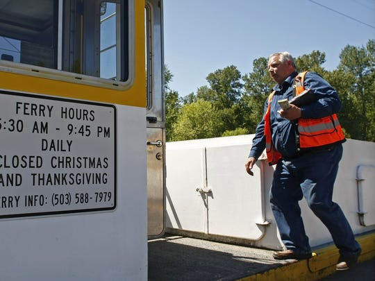 Ed Watson, a senior ferry operator with Marion County Public Works, heads to the wheel house after collecting fares on the on the Wheatland Ferry on Wednesday, Apr. 30, 2014. Watson has been operating the Wheatland and Buena Vista ferries for nearly 20 years.
