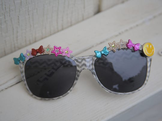 Personalize a pair of inexpensive sunglasses with a few small embellishments.