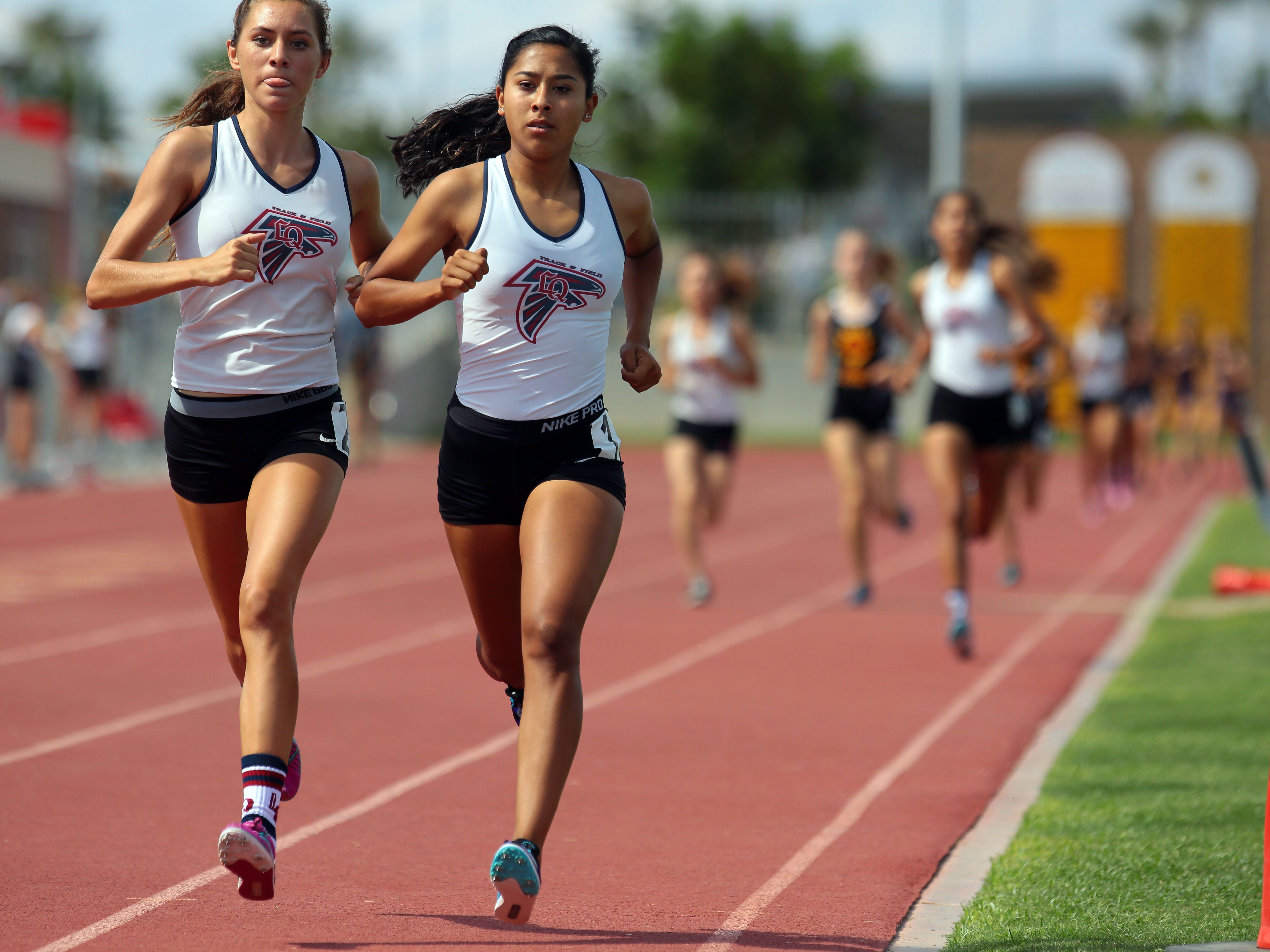 La Quinta's Marisa Rodriguez, right, and Sandra Flores compete in the 1600 on Thursday in Palm Desert. Rodriguez won the race with Flores in 2nd place.