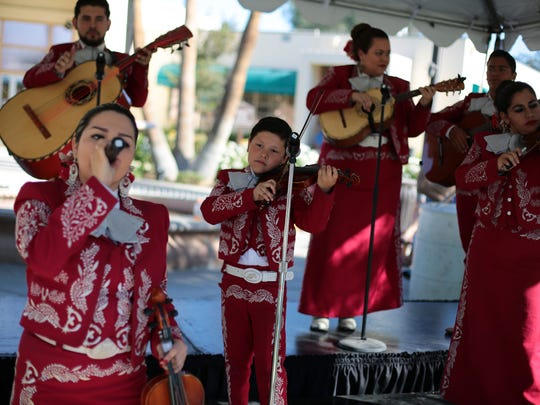 Mariachi Orgullo Azteca perform at the City of Coachella's Cinco De Mayo celebration on Saturday.