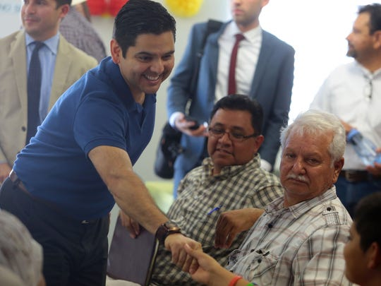 U.S. Congressman Dr. Raul Ruiz greet a gathering at the San Jose Community Learning Center in Thermal. The congressman was in Thermal to discuss U.S. Department of Agriculture grants to improve the water and sewer system for San Cristobal, and the San Antonio del Desierto mobile home parks.