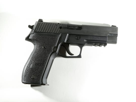 This is a Sig Sauer 9mm P226 handgun, similar to the pistol carried by Arizona Highway Patrol Officer Bill Martin. Ernesto Martinez took a gun like this off of Martin's corpse, then allegedly used it to kill Randip Singh in Blythe. Photo taken at Second Amendment Sports in Palm Desert.