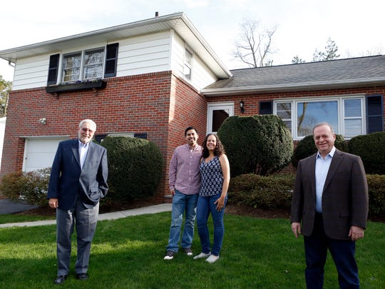 Levy and Jadera Garcia bought their first home with the help of Gary Slutsky, left, and Gary Herbst, realtors with Buyer's Edge Realty, Inc. They are photographed April 30, 2015 in White Plains.