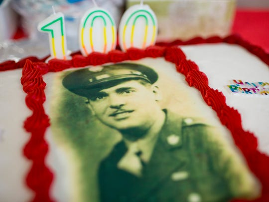A birthday cake with a photograph during a 100th birthday party for Walter Krupa, a World War II veteran, Saturday, May 9, 2015 at American Legion Post 525 in Smith's Creek.