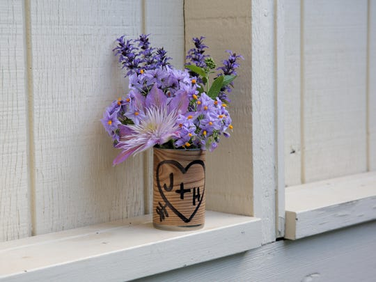 """Make a sweetly sentimental statement with the happy couple's initials """"carved"""" into a woodgrain treatment on a recycled can."""