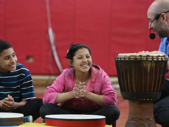 From left, Yoskar Agustin-Sanchez and Jaqueline Galdamez, both 11, watch as guest musician Adam Issadore from the Rockland Conservatory of Music teaches fifth graders how to play drums at Hempstead Elementary School in the East Ramapo school district.