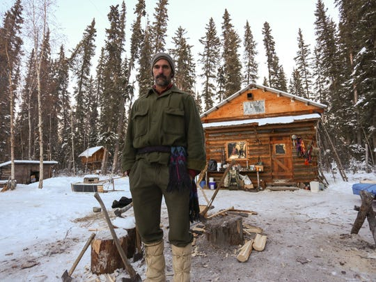 Ray Lewis stands outside his cabin.