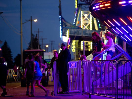 Kids exit a centrifuge ride during Marysville Days Wednesday, June 10, 2015 along River Road.
