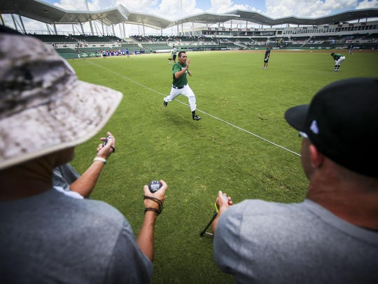 A player is timed during his 60-yard dash at JetBlue Park. Wednesday, June 18th, 2015. A look at the Perfect Game National Showcase and its importance to MLB.The high school baseball equivalent of the NFL Combine visits Fort Myers with a twist: SaturdayÕs game will be livestreamed and later nationally televised for the first time. The whoÕs who of high school baseball draws more than 200 Major League Baseball scouts (the Minnesota Twins had five scouts on hand) plus college coaches from across the country. But the four-day event receives little fanfare or media attention.