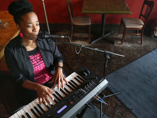 Des Moines singer and songwriter, D'Monet plays keyboard
