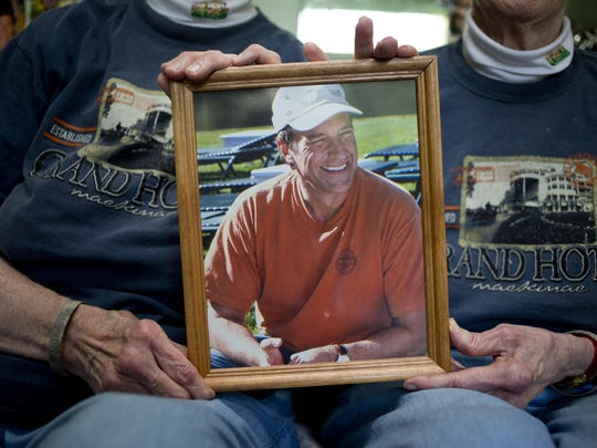Twins Carolyn and Marilyn Maedel hold a photograph of Mike Rowe at their home in St. Clair. The two have been on several shows with Mike Rowe, and are unofficially considered his biggest fans.