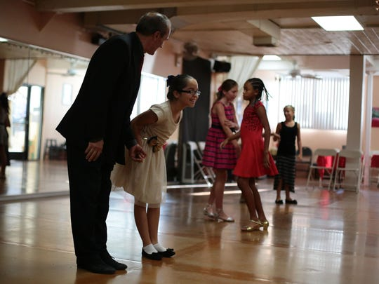 Montserrat Maciel, 10, takes a bow with her dance teacher Isa Lapaj during an end of class ballroom dance recital at the Step-by-Step Dance Studio in Palm Springs on Tuesday.