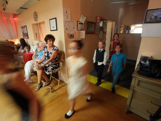 Dance students take to the dance floor for an end of class ballroom dance recital at the Step-by-Step Dance Studio in Palm Springs on Tuesday.