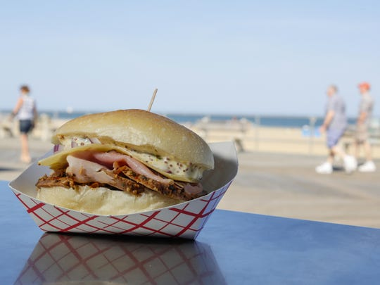 The pork sandwich from Hoagitos on the Asbury Park boardwalk is made with roasted pork, pepper jack cheese, tomato and cilantro-lime mayo.