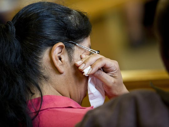 Shawna Reyna, sister of Regina Reyna, wipes tears with a tissue during a preliminary examination for Aaron Swift Tuesday, July 14, in the courtroom of Judge John Monaghan at the St. Clair County Courthouse.