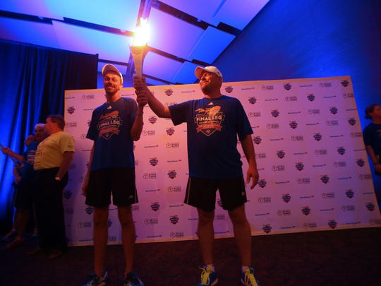 Participants in the Law Enforcement Torch Run's Final Leg for 2015 Special Olympics World Games take turn with the torch at the end of the run at the Palm Springs Convention Center on Saturday.