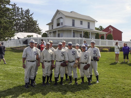 "Ghost players pose together for a picture at the ""Field of Dreams"" movie site in 2014 near Dyersville. The stop is a must-see on a road trip to northeast Iowa."