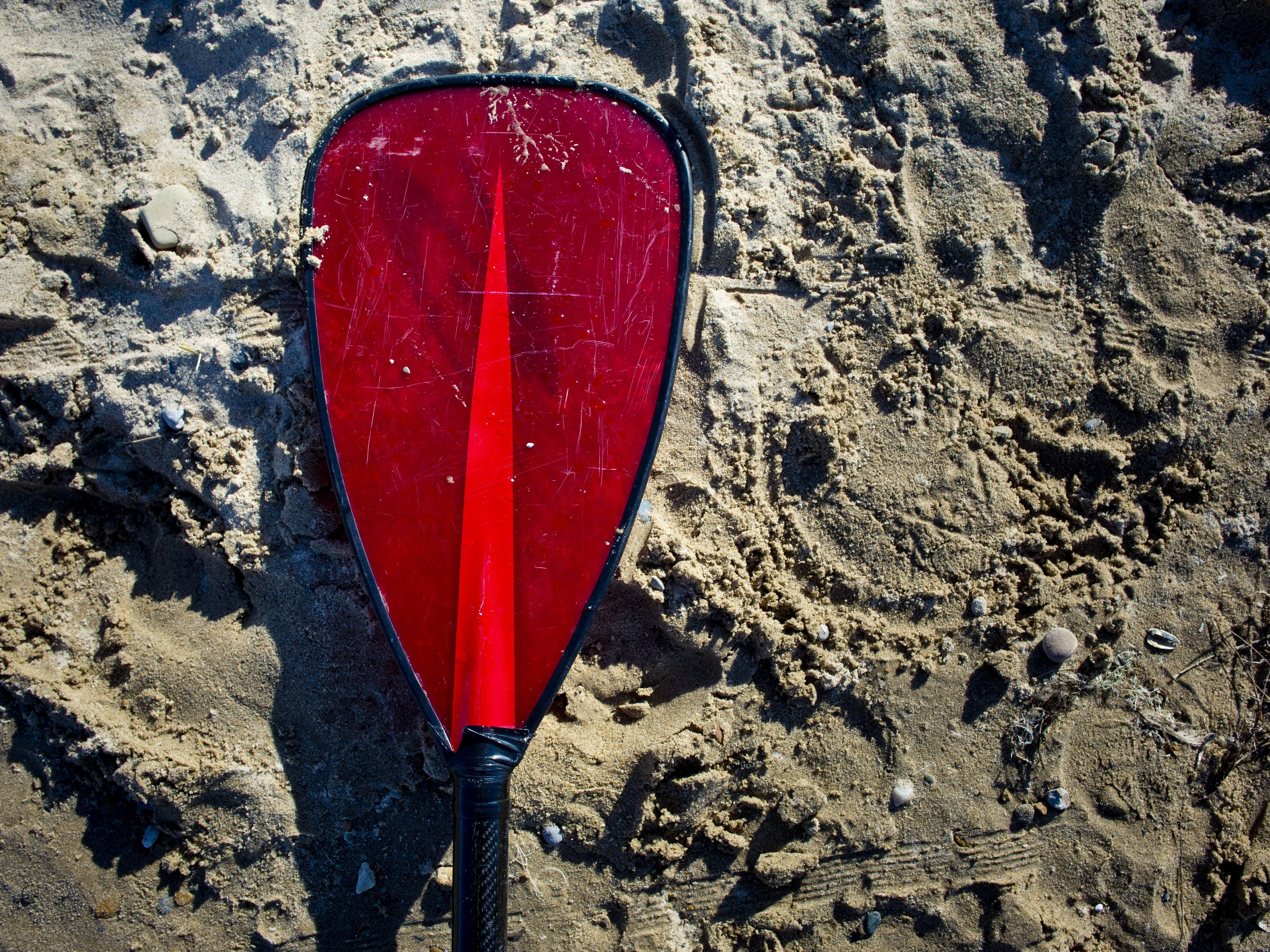 A paddle lays on the beach during a stand up paddle board class Wednesday, July 22, 2015 at Lakeside Beach in Port Huron.
