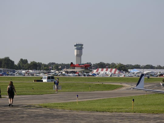 Oshkosh Northwestern Media reporter Noell Dickmann took an aerobatic flight on an Extra 300L with Screamin' Sasquatch pilot Jeff Boerboon at EAA AirVenture 2015.