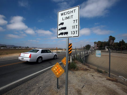 A sign shows the weight limits for the Stetson Avenue Bridge in Hemet on Thursday. It's the worst bridge in Riverside County.