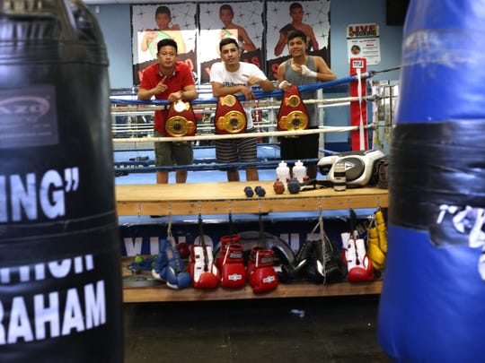 From left, Brandun Lee, Anthony Reyes and Rommel Caballero all placed first during the 2015 Desert Showdown amateur boxing competition.