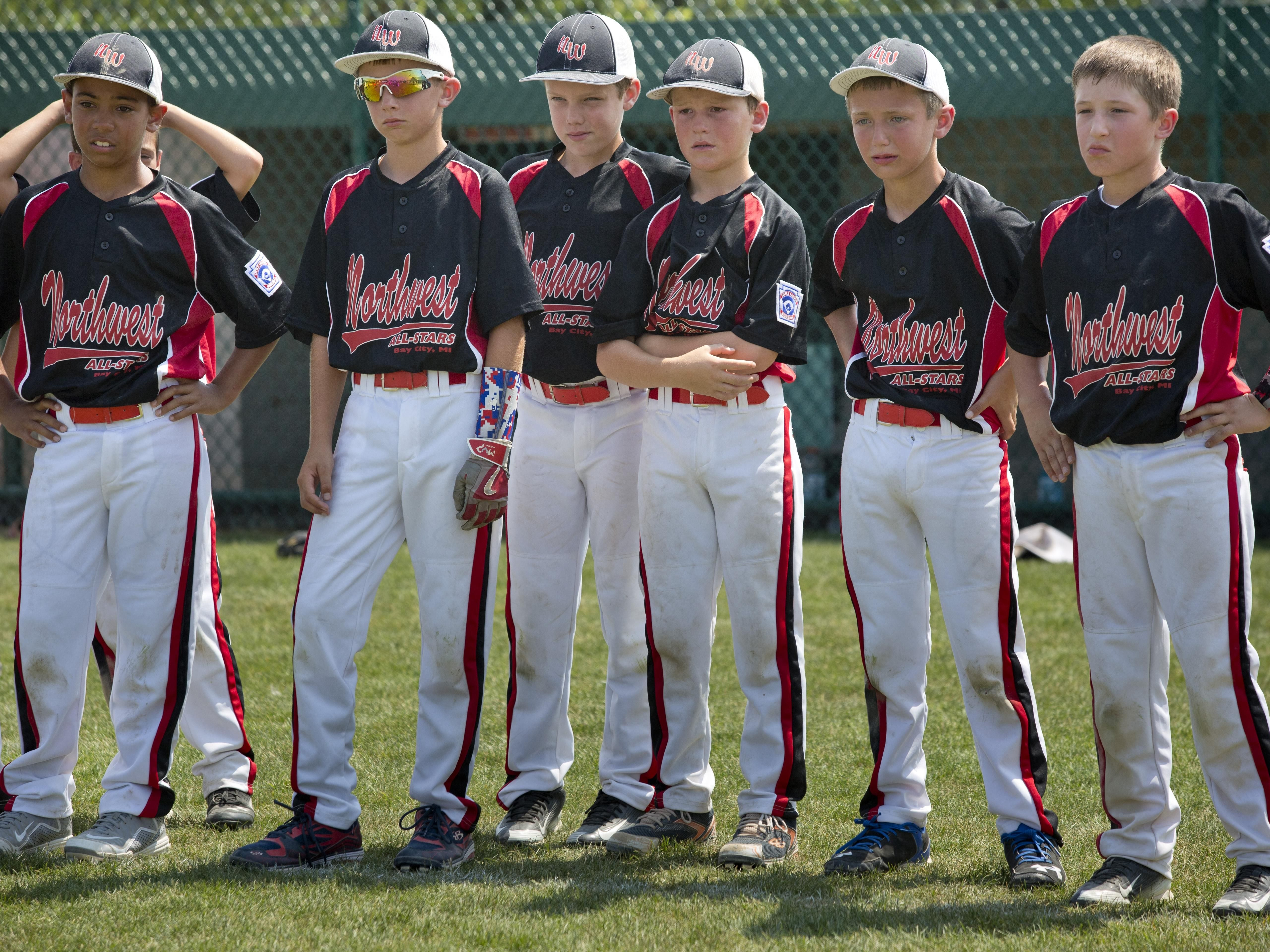 Bay City Northwest players look on after losing a state final 10-and-under baseball game Wednesday, July 29, 2015 in St. Clair.