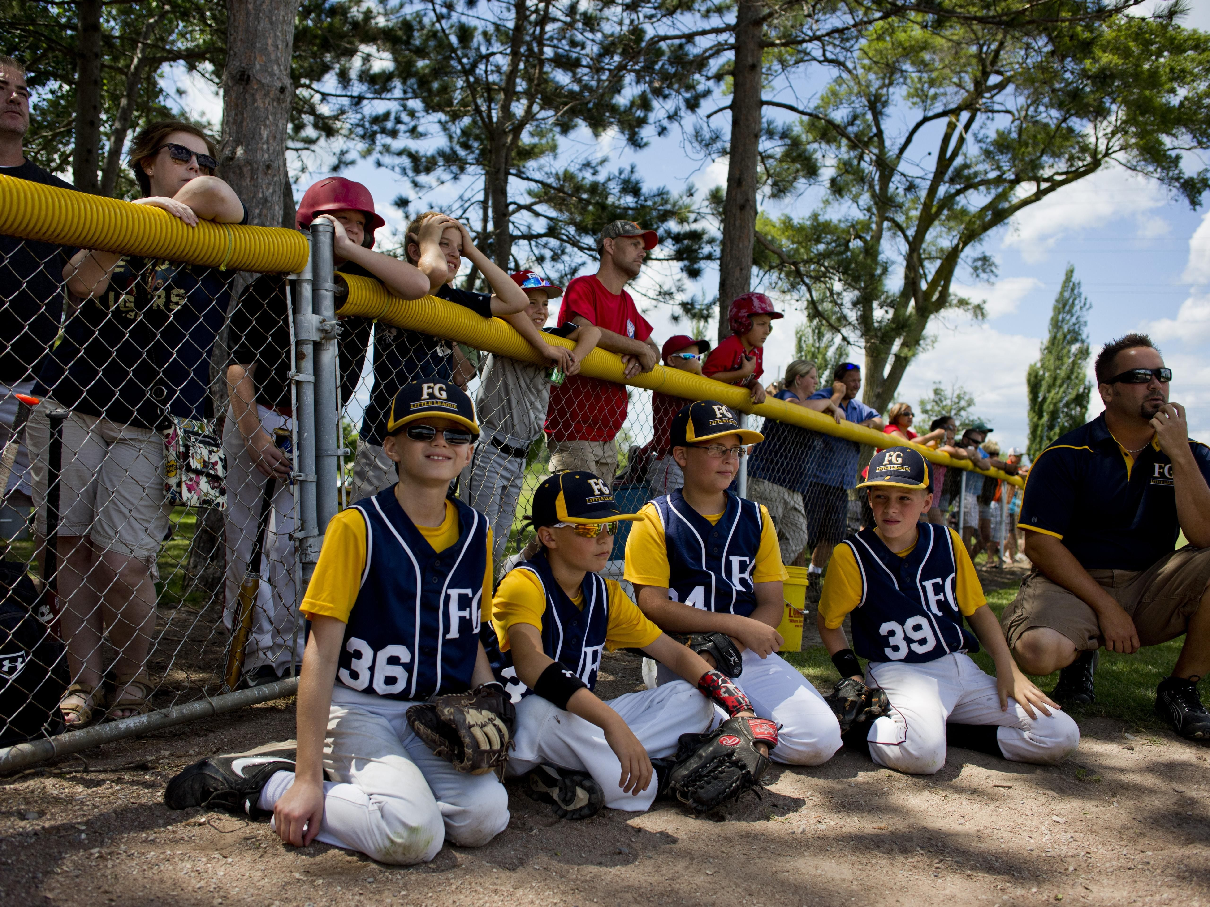 Members of the Fort Gratiot team and spectators watch from the sidelines during a Little League skills competition Saturday, August 1, 2015 at Marysville City Park.