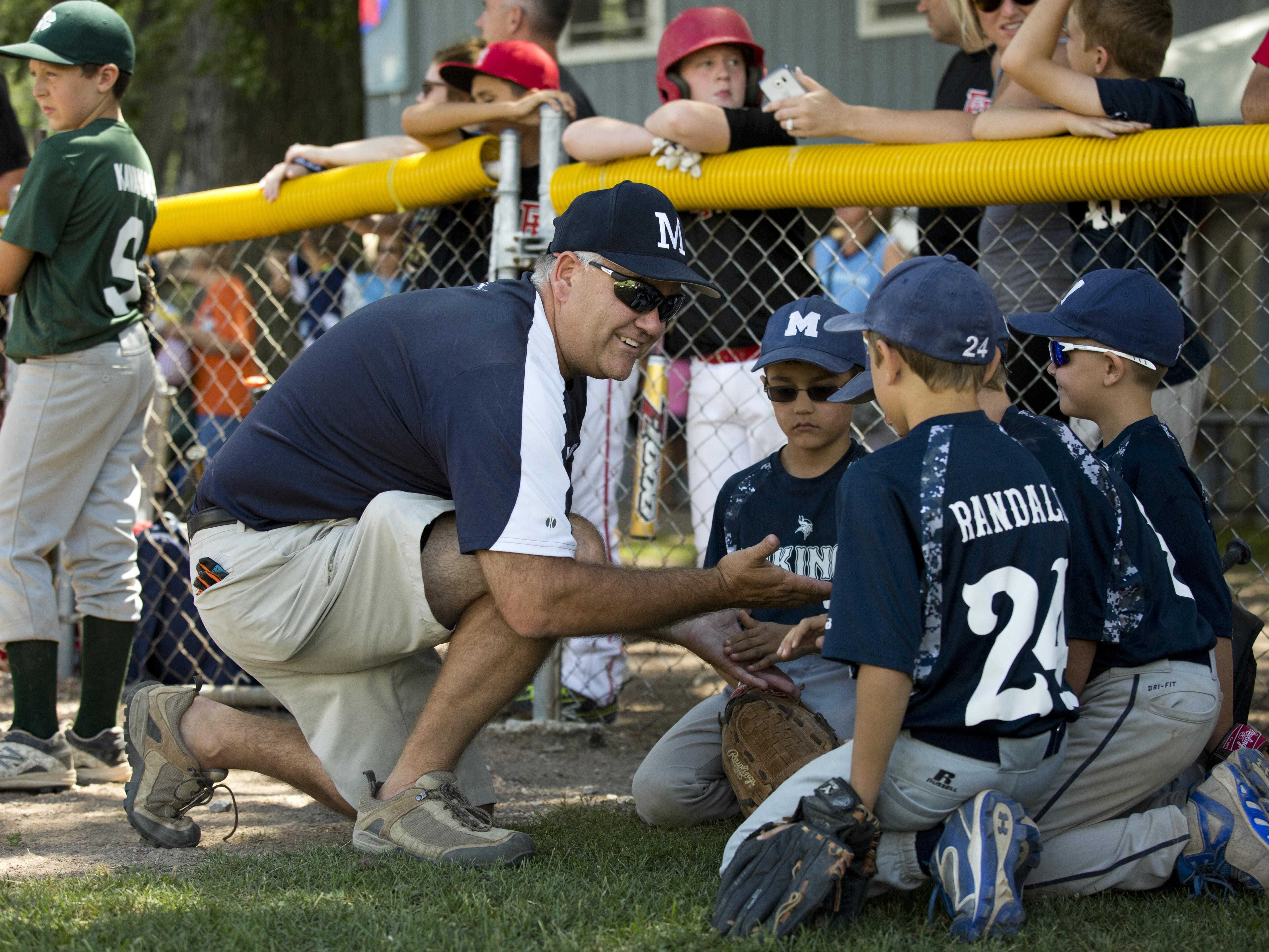 Marysville coach Don Paterson encourages players before the compete during a Little League skills competition Saturday, August 1, 2015 at Marysville City Park.
