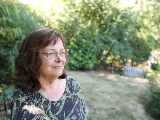 West Salem resident Jackie Klimowicz is photographed on Tuesday, Aug. 4, 2015, in her backyard. She said she hasn't been watering her lawn for most of the year.