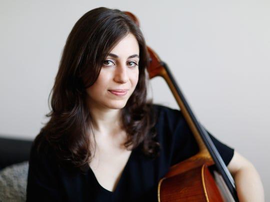 Cello player Karen Ouzonian performs as part of Scrag