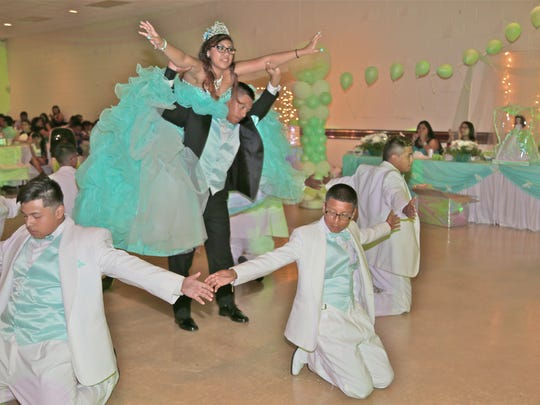 "The quinceanera and her court end the waltz ""El vals de las mariposas,"" the waltz of the butterflies, with a dramatic lift."