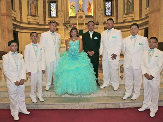 La quinceanera and her court: from left, Eduardo Marquez, 15; Thomas Pecellin, 12; Jose Rodriguez, 15; Veronica Mendez, 15, quinceanera; Mario Moreno, 15, chambelan of honor; Jonathan Abrego, 15; Pedro Ayon, 15; and Alejandro Ortiz, 13.