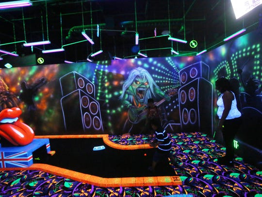 Black lights at the Rock 'N' Roll MiniGolf is the main attraction of this 18-hole mini golf game in La Quinta.