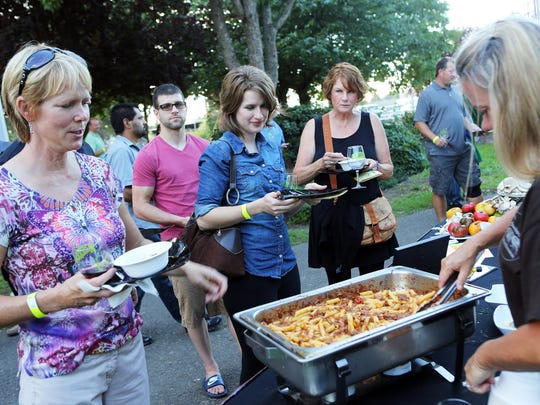 People line up to taste the lamb bolognese from Gamberetti's during the Pairings! event in 2013.