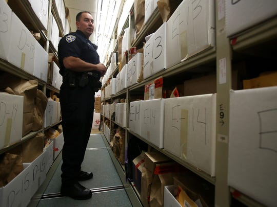 Salem Police Lt. Jim Aguilar in an evidence locker in the current police station. Photo taken on Monday, Aug. 11, 2014 in Salem, Ore.