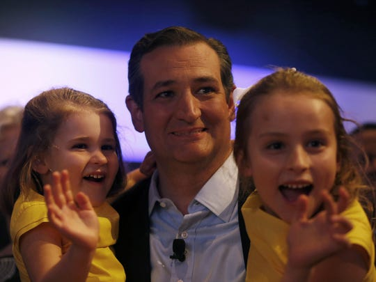 Republican Ted Cruz sits with daughters Catherine (left) and Caroline before giving his speech Friday, Aug. 21, 2015 at the Rally for Religious Liberty in Des Moines.