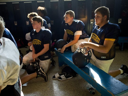 Northern players listen in the locker room during practice on Aug. 15 at Memorial Stadium. The Huskies open the season with two games on the road.